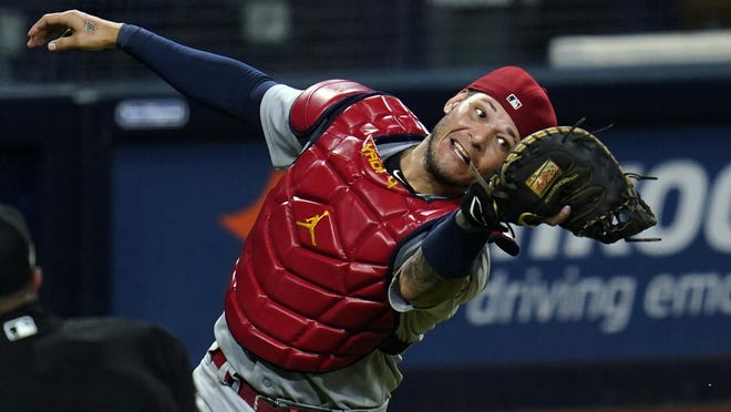 St. Louis Cardinals catcher Yadier Molina makes the catch of a foul ball for the out on San Diego Padres first baseman Eric Hosmer during the eighth inning of Game 2 of a National League wild-card baseball series Thursday, Oct. 1, in San Diego.