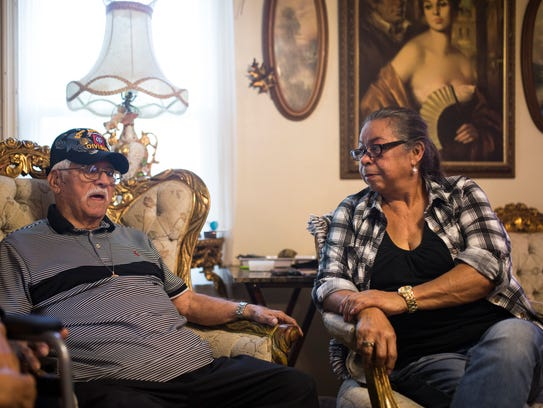 John Duran, 93 (center) speaks about searching for his daughter Evelyn Bracy (right) as they sit in his home on Monday, Dec. 11, 2017 in Corpus Christi. Duran was recently reunited with daughter Evelyn Bracy after being separated from her when she was seven.