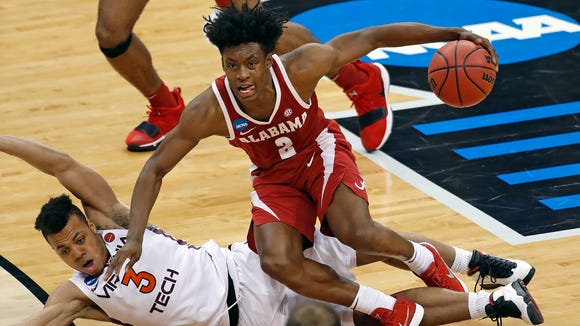 Alabama 's Collin Sexton (2) collides with Virginia Tech's Wabissa Bede (3) and draws an offensive foul during the second half of an NCAA men's college basketball tournament first-round game in Pittsburgh, Thursday, March 15, 2018. Alabama won 86-83. (AP Photo/Gene J. Puskar)