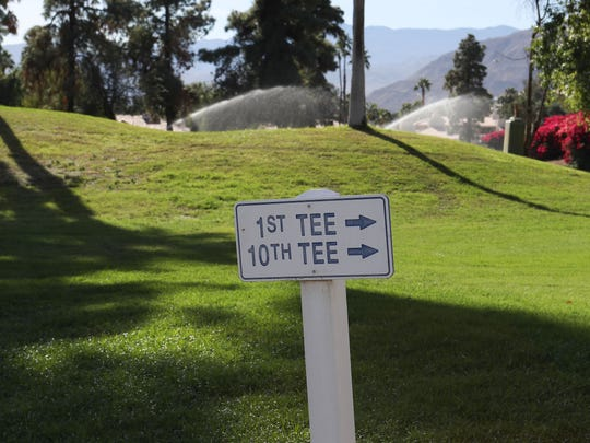 Old signs pointing to holes that no longer exist are still seen at Rancho Mirage Country Club.