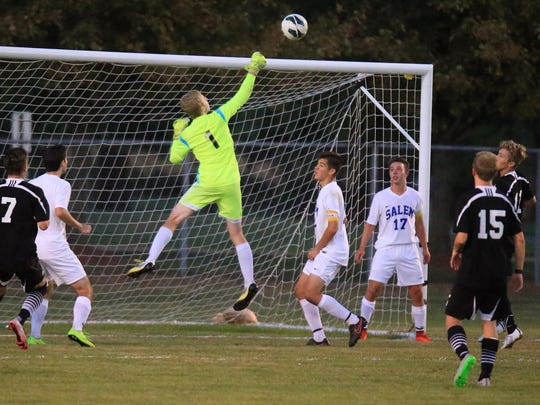 Showing some serious hops to deflect a Plymouth shot over the net is Salem goalkeeper Karson Gregory. Among other players pictured is Rocks midfielder Max Kummer (No. 17) and Plymouth forwards Mike Blake (No. 7) and Keaton Hegarty (No. 15).