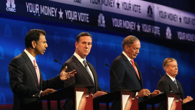 From left: Bobby Jindal, Rick Santorum, George Pataki and Lindsey Graham meet in Boulder, Colo., on Oct. 28, 2015, for a GOP undercard debate.