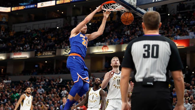 New York Knicks forward Doug McDermott (20) dunks the ball over Indiana Pacers forward Domantas Sabonis (11) during the first quarter at Bankers Life Fieldhouse