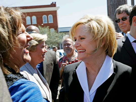 Mississippi Agriculture Commissioner Cindy Hyde-Smith, right, is congratulated by a friend Wednesday in her hometown of Brookhaven after being selected by Gov. Phil Bryant, to succeed fellow Republican Thad Cochran in the U.S. Senate.