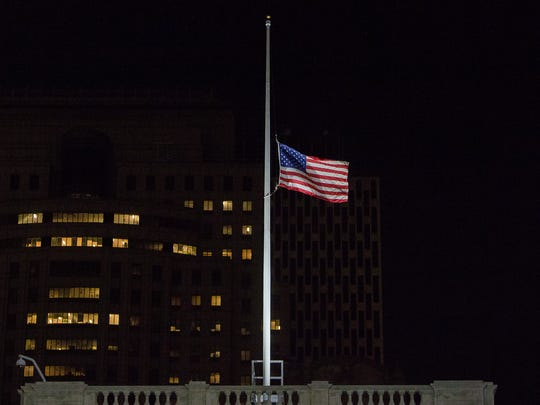 The American flag that flies over New York City Hall is lowered to half-staff in honor of the 49 victims of the mass shooting at a gay nightclub in Orlando.