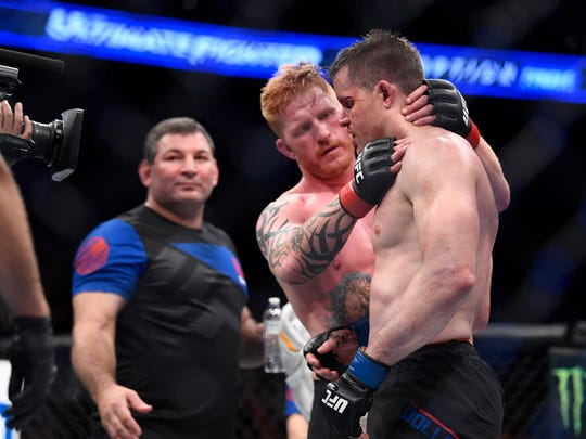 Northmor grad C.B. Dollaway receives congratulations from light heavyweight opponent Ed Herman after winning by unanimous decision in their UFC bout July 7 in Las Vegas.