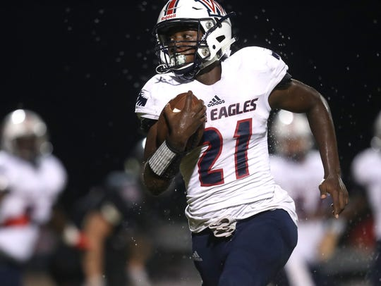 Wakulla's Lamonta Peterson runs with the ball against