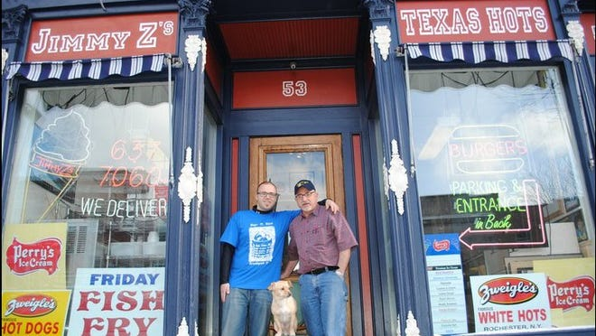 "Jimmy and Sterio ""Pappi"" Zisovski with dog Axel at Jimmy Z's Texas Hots."