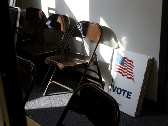 Voting placards sit in light at the Recreation Center
