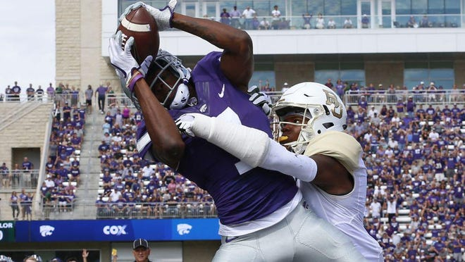 Among the undrafted free agents cut during the weekend by the Patriots is former Kansas State wide receiver Isaiah Zuber, shown grabbing a touchdown pass against Baylor during a game in September 2017 in Manhattan, Kan.