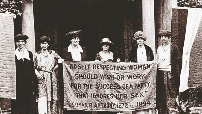Chairwoman Alice Paul, second from left, and officers of the National Woman's Party hold a banner with a Susan B. Anthony quote in front of the NWP headquarters in Washington, D.C., June 1920.  The suffragettes are ready for the G.O.P. convention to seek support for the ratification of the 19th Amendment granting women the right to vote. The other suffragettes are, Sue White, Mrs. Benigna Green Kalb,