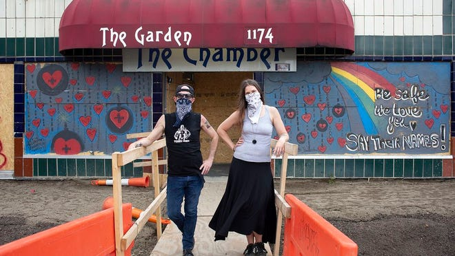 Doug Cuckler, left, and Lacey Thompson outside of the Garden in the Short North