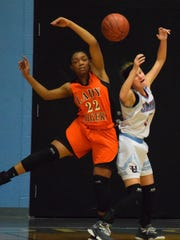 Ashley Conway collides with her Hopkinsville opponent