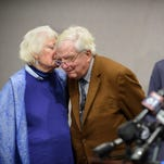 Ellen Kennedy whispers to her husband, Moorhead Kennedy, 85, who was among the American hostages held at the U.S. Embassy in Iran from 1979 to 1981, during a  Jan. 4, 2016, press conference in Hartford, Conn. Sen. Richard Blumenthal, D-Conn., right, co-sponsored a bill with Sen. Johnny Isakson, R-Ga., that created a fund from fines against banks violating U.S. sanctions against Iran. Through the fund, Moorhead and fellow hostages each will receive $4.4 million.