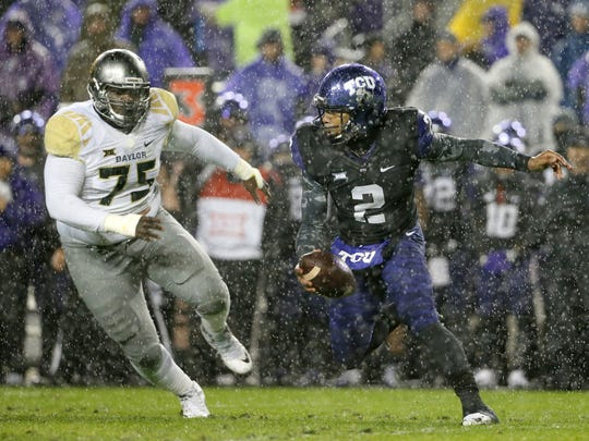 Tony Gutierrez/AP TCU quarterback Trevone Boykin, right, scrambles while under pressure from Baylor defensive tackle Andrew Billings in the first half of the Horned Frogs? double-overtime victory. TCU quarterback Trevone Boykin (2) scrambles out of the pocket under pressure from Baylor defensive tackle Andrew Billings (75) in the first half of an NCAA college football game, Friday, Nov. 27, 2015, in Fort Worth, Texas. (AP Photo/Tony Gutierrez)