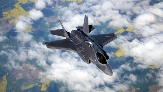 A US Air Force F-35 Lightning II assigned to Hill Air Force Base, Utah, flies alongside a 100th Air Refueling Wing KC-135 Stratotanker during a flight to Estonia on April 25, 2017.