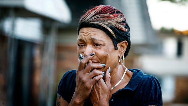 Neighbor Yumekia Harris reacts to the damage at the apartment fire Tuesday at the Ten Mile Creek Apartments.