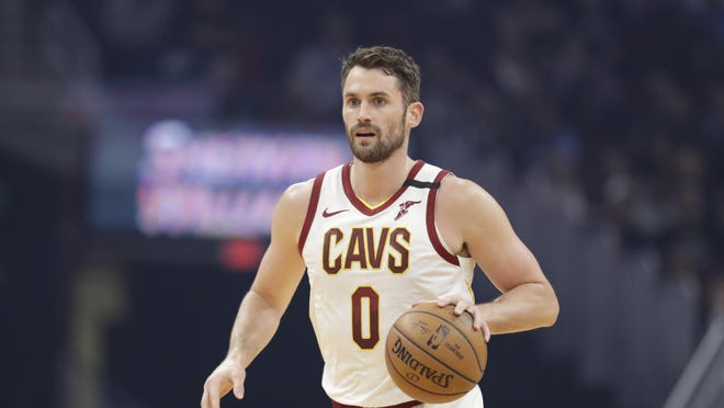 Cleveland Cavaliers' Kevin Love drives against the Miami Heat in the first half of an NBA basketball game, Monday, Feb. 24, 2020, in Cleveland.