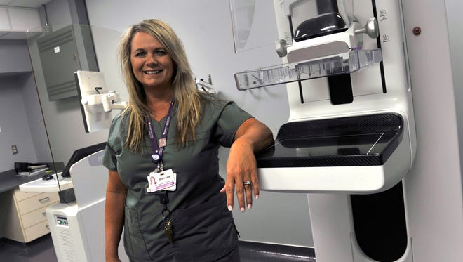 Melissa Yarbrough, the supervisor for Women's Diagnostics at Abilene Regional Medical Center, stands beside the hospital's 3D mammography imaging machine Tuesday June 27, 2017.