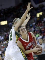 Hortonville's Macy McGlone drives to the basket against Beaver Dam's Afton Bartol during their 2018 Division 2 state semifinal game at the Resch Center in Ashwaubenon.