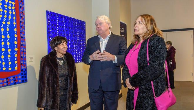 """Collector Dennis Scholl speaks about the contemporary Aboriginal art in """"No Boundaries"""" with Roberta Wright (left) and Barbara Jean Smith at the Charles H. Wright Museum of African American History"""