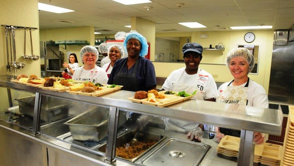 St. Joseph Diner volunteers serve meals to those experiencing poverty and homelessness in Acadiana.