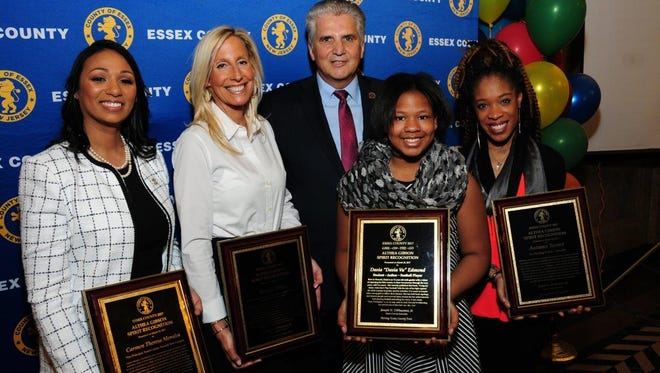 """From left: Carmen Morales, vice principal of Essex County Newark Tech Campus; Margie Heller, administrative director of Community Health and Outreach at St. Barnabas Medical Center in Livingston; Essex County Executive Joseph N. DiVincenzo Jr.; Dasia Edmond, author of the children's book """"Uniquely Made: Girls Don't Play Football""""; and Autumn Turner of Montclair, ice skating teacher at Essex County Codey Arena and a contestant on """"The Voice."""""""