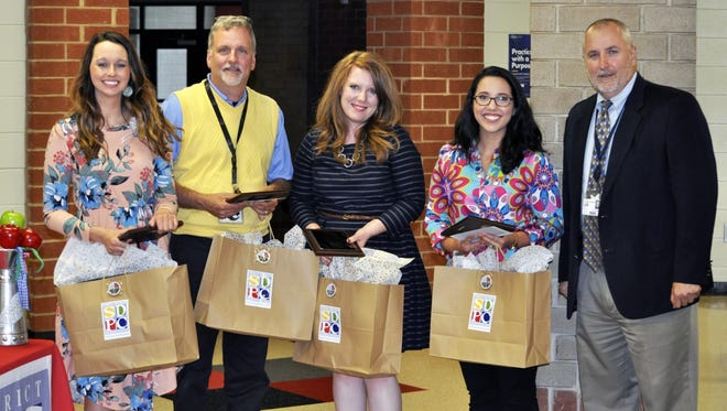 Shown, starting from left is Outstanding First Year Teacher of the Year Anna Bross, and teacher finalists are Dr. Steven Jackson, Kayla Wells and Caroline Anderson, and Dr. Danny Merck, SDPC Superintendent.