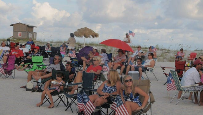 Navarre Beachgoers relax and listen to good music at Tunes at the Dunes.
