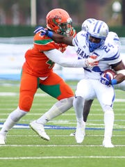 Linebacker Akil Blount tries to bring down a Hampton runner during FAMU's 33-0 loss to the Pirates