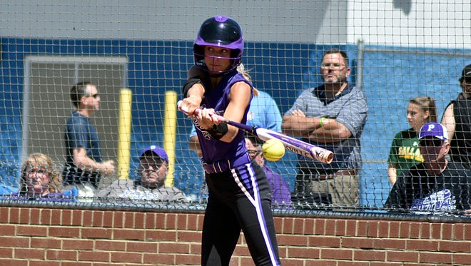 Portland's Olivia West connects for a fifth-inning single  during Saturday's District 9-AAA Tournament championship game against  Mt. Juliet.