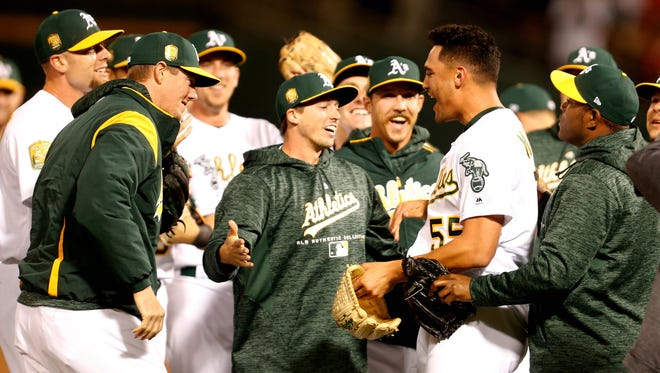 Athletics pitcher Sean Manaea (55) celebrates with teammates after pitching a no-hitter against the Red Sox at Oakland Coliseum.