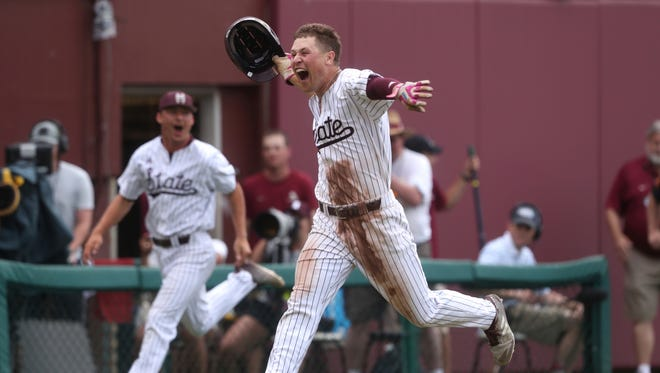 Mississippi State's Elijah MacNamee celebrates his walk-off 3-run home run to defeat Florida State 3-2 in their NCAA Regional elimination game at Dick Howser Stadium in Tallahassee, Fla., Saturday, June 2, 2018. (Joe Rondone/Tallahassee Democrat via AP)
