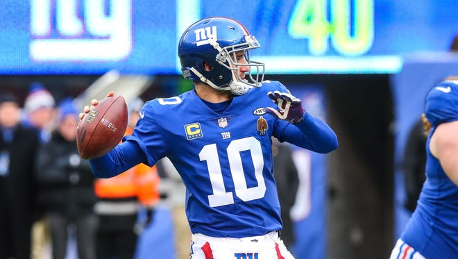 Dec 31, 2017; East Rutherford, NJ, USA; New York Giants quarterback Eli Manning (10) throws the ball during the first quarter against the Washington Redskins at MetLife Stadium. Mandatory Credit: Vincent Carchietta-USA TODAY Sports