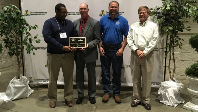 Accepting the awards at the Kentucky Recreation and Parks Society conference were, from left: City of Henderson Parks and Recreation Director Trace Stevens, Gary Parsons, Recreation Program Manager Mark Simmons, and Assistant Henderson City Manager Buzzy Newman.