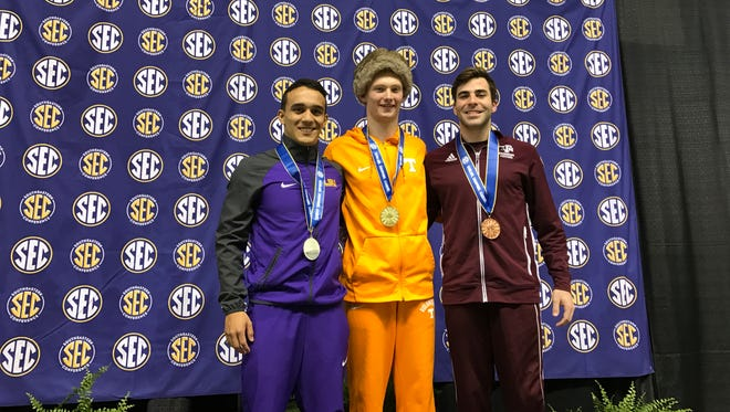 Tennessee junior Liam Stone, center, won the 1-meter springboard title at the SEC Swimming and Diving Championships on Tuesday night with a record score.
