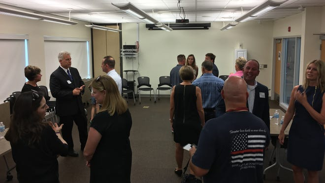 Five finalists for the open North Liberty fire chief position meet the public at a reception at the North Liberty Community Library Wednesday night.
