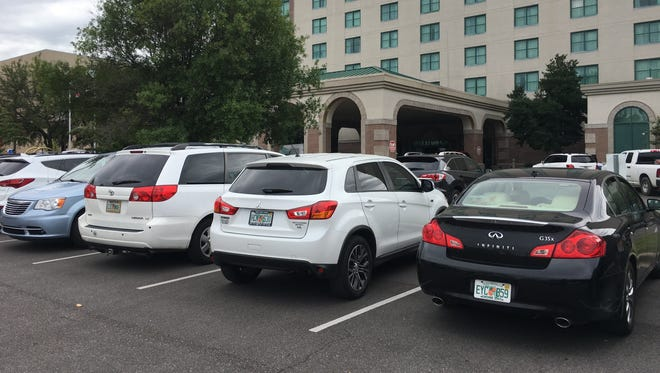 Vehicles with Florida license plates fill hotel parking lots across Montgomery. State officials said 250,000 Floridians were in Alabama because of Hurricane Irma.