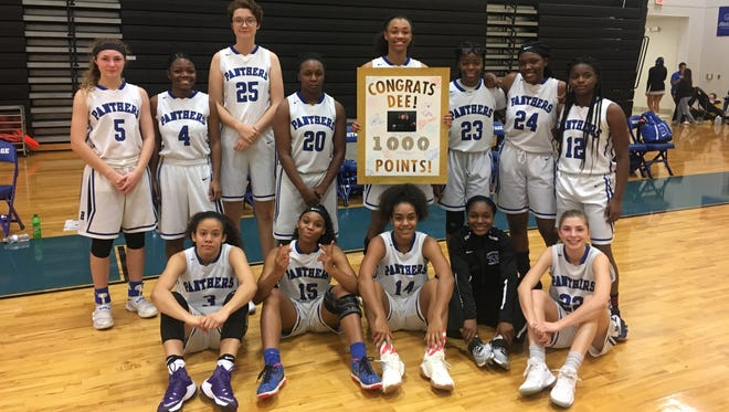 Dee Lampkin holds a commemorative plaque from the night she passed 1,000 career points for her Heritage High girls basketball career.