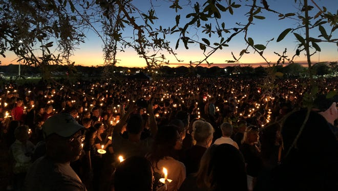 Scenes from the candlelight vigil Thursday, Feb. 15, 2018, at City of Parkland amphitheater in honor of those slain and injured in the mass shooting at Marjory Stoneman Douglas High School.