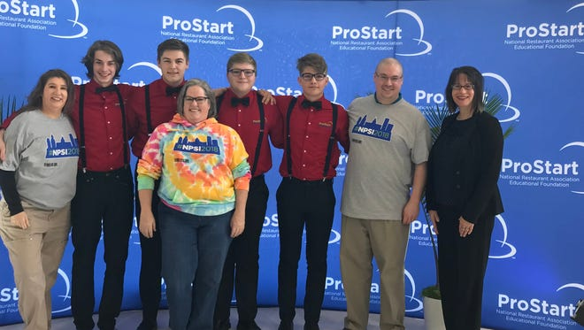 Four students from Des Moines school's Central Campus placed 10th out of 46 teams at the National ProStart Invitational in April 2018 for their restaurant concept. Pictured are ProStart educator Monica Wilson-Cross, students Tyler Scar, Josh Thompson, Mason Bolser, Max Dixon, mentor John Andres, Iowa Restaurant Association Education Foundation executive director May Schaben and Thompson's mother.