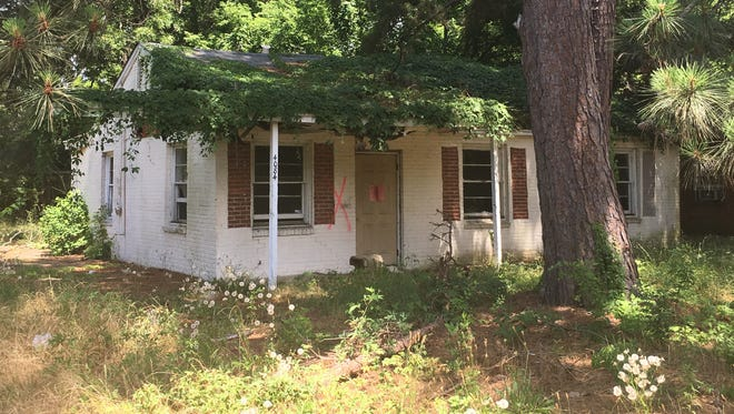 A house on the 4000 block of Gaston Avenue is scheduled for demolition.