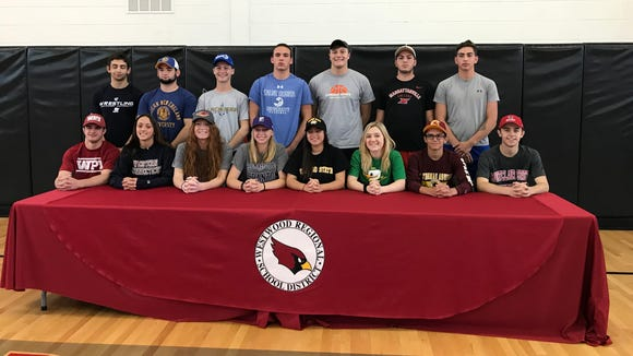 The 17 senior athletes at Westwood gather for a Signing Day photo.