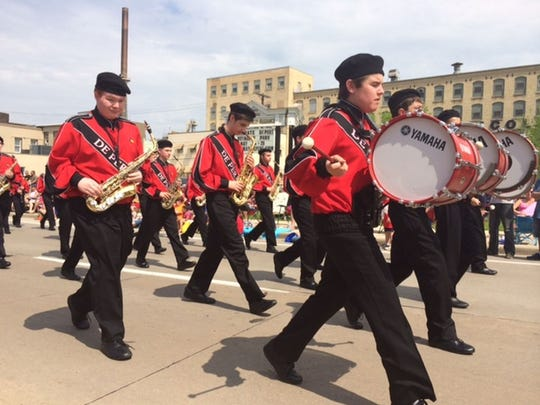 The De Pere High School band plays during the 2014