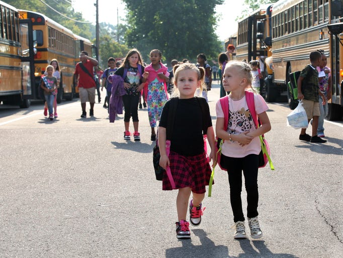 Ringgold Elementary students unload buses as Clarksville Montgomery County School System resume classes Wednesday for the 2014-15 school year.