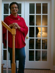 Velma McMillian of Middletown wears Not Your Mother's Jeans, a red long-sleeve tee and red cable-knit poncho from Talbots and Sam Edelman black ankle booties.
