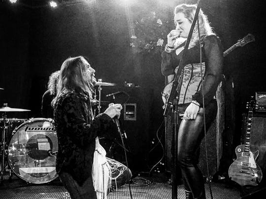 Matt O'Ree on bended knee in front of Eryn Shewell at the Wonder Bar in Asbury Park on Dec. 23, 2016.