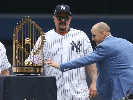 David Wells watches as general manager Brian Cashman