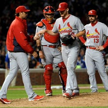 Sep 23, 2014; Chicago, IL, USA; St. Louis Cardinals starting pitcher Shelby Miller (40) gives the ball to Mike Matheny (22) as he's taken out of  the game against the Chicago Cubs during the fifth inning at Wrigley Field. Mandatory Credit: David Banks-USA TODAY Sports