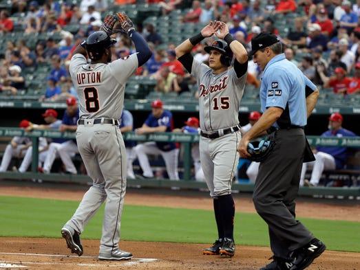 Tigers leftfielder Justin Upton (8) and centerfielder